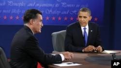 President Barack Obama listens as Republican presidential nominee Mitt Romney speaks during the third presidential debate at Lynn University, in Boca Raton, Florida, October 22, 2012.