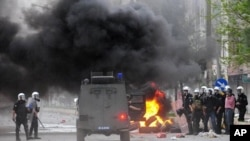 Riot police clash with Kurdish protesters in the town of Bismil, near the southestern Turkish city of Diyarbakir, April 21, 2011