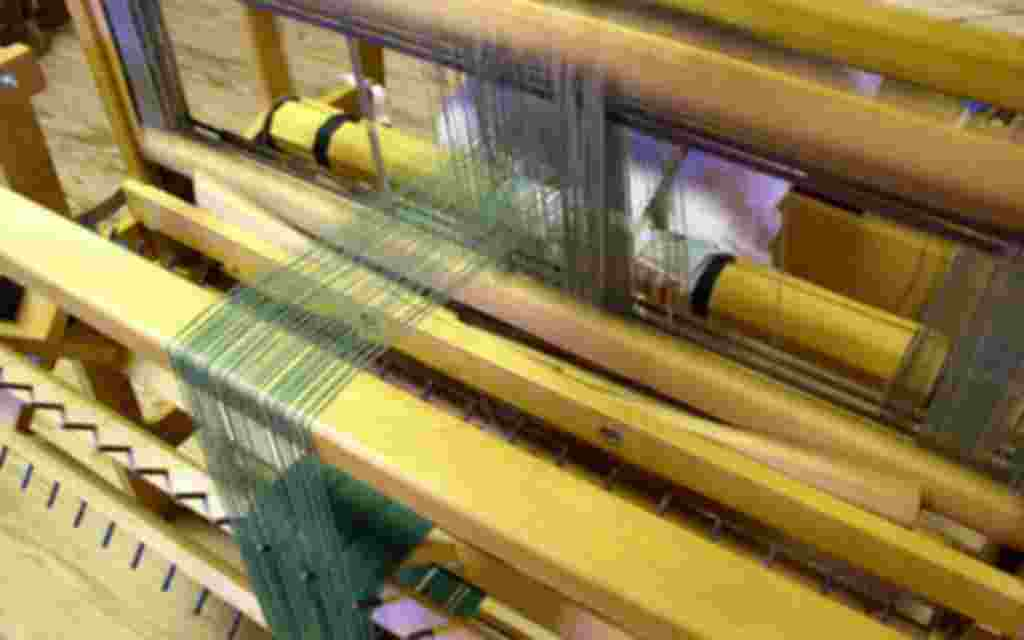 Crafts, a weaver at the loom
