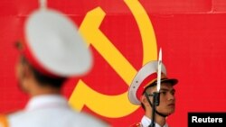 Military soldiers stand guard in front of the symbol of Vietnam's Communist Party during a ceremony to mark the 85th anniversary of its foundation in Hanoi February 2, 2015. Vietnam on Monday celebrates the anniversary of its ruling party, which the late
