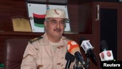 FILE - Renegade general Khalifa Haftar speaks during a news conference after surviving an assassination attempt in Al Marj, east of Benghazi, Libya, June 4, 2014.
