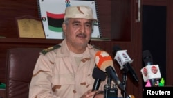 FILE - Eastern Libyan military commander Khalifa Haftar speaks during a news conference in Al Marj, east of Benghazi, Libya, June 4, 2014.