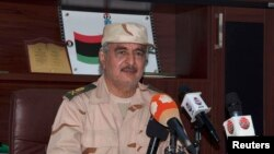 FILE - General Khalifa Haftar speaks during a news conference in Al Marj, east of Benghazi, Libya, June 4, 2014. Hafter's forces say they have pounded Islamist militia fighters who captured key oil ports in the country.