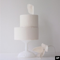 "Maggie Austin's ballet aesthetic is evident in her creations. ""A lot of times, with my cakes, there's always an element that goes up and off to the right a little bit, angling upwards,"" she says."