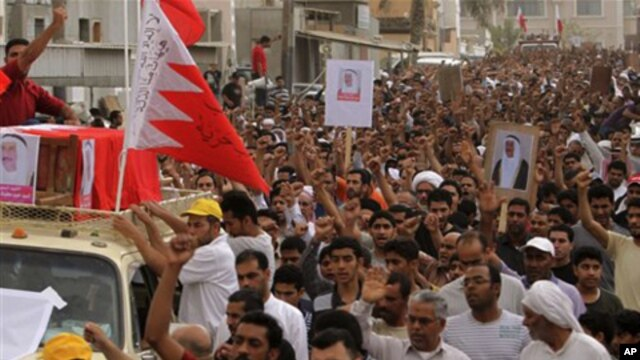 Thousands chant anti-government slogans as they march during a funeral procession for Sayed Hameed Mahfoodh, 61, in the western Shiite Muslim village of Saar, Bahrain, April 6, 2011