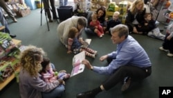 Massachusetts gubernatorial candidate Republican Charles Baker reads 'The Snowy Day,' by Ezra Jack Keats on National Literacy Day to children at a toy store in Canton, MA, USA. (File Photo - October 7, 2010)