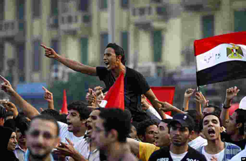 Egyptian protesters chant as they hold a demonstration after Eid al-Fitr in Tahrir Square in Cairo, Egypt, Aug. 30, 2011. AP