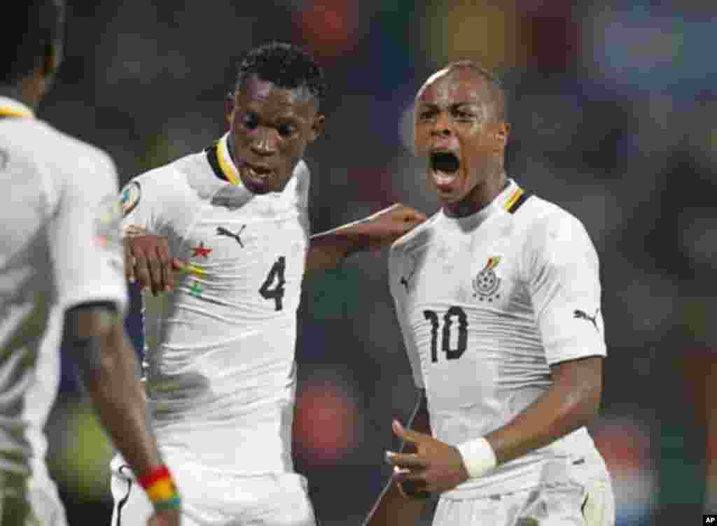 Ghana's Ayew Andre Morgan Rami (R) celebrates his goal with John Paintsil during their African Cup of Nations Group D soccer match against Mali in FranceVille Stadium, January 28, 2012.
