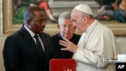 FILE - Pope Francis talks with Congo President Joseph Kabila during a private audience in the pontiff's studio, at the Vatican, Sept. 26, 2016.
