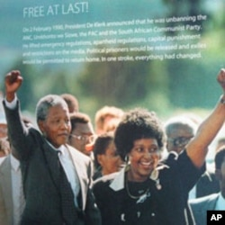 At exhibit at the Apartheid Museum in Johannesburg illustrating a photograph of Nelson Mandela's walk from prison with his then spouse, Winnie Mandela