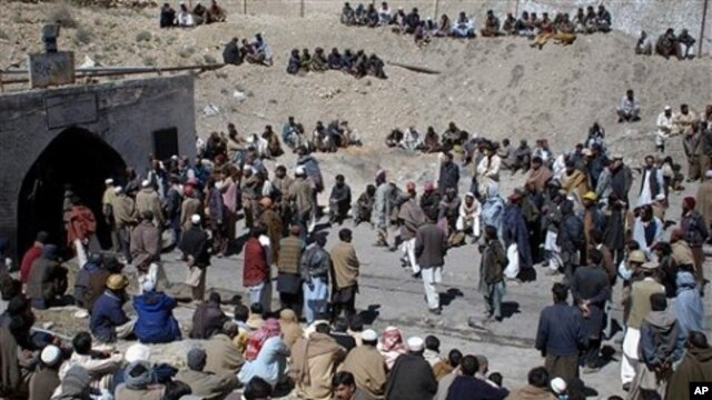 Mine workers and residents gather outside a coal mine after a explosion in Sorange near Quetta, Pakistan, March 20, 2011