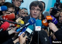 FILE - Fugitive Catalan leader Carles Puigdemont addresses the media in Brussels, Belgium, Jan. 24, 2018.