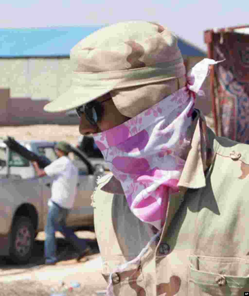 The NTC has yet to issue regular uniforms, Bani Walid, Libya, 11 September 2011. - E. Arrott