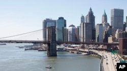 The Brooklyn Bridge and lower Manhattan skyline are shown in a view from the Manhattan Bridge, New York