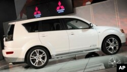 In an April 9, 2009 photo, the Mitsubishi Outlander GT is introduced at the 2009 New York International Auto Show. Mitsubishi is recalling two SUV models to fix problems that could cause the windshield wipers to malfunction.
