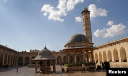 Visitors walk inside Aleppo's Umayyad mosque, Syria Oct. 6, 2010.