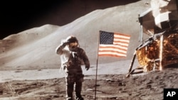 July 30, 1971 NASA photo, Apollo 15 Lunar Module Pilot James B. Irwin salutes while standing beside the fourth American flag planted on the moon.
