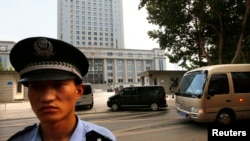 FILE - Police outside the Jinan Intermediate People's Court, Jinan, Shandong province.