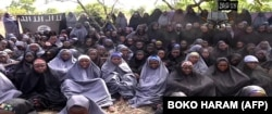 A video from Boko Haram claims to show the abducted Nigerian schoolgirls wearing full-length hijabs and praying in an undisclosed location in a screengrab taken May 12, 2014.