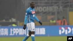 Napoli's Kalidou Koulibaly leaves the pitch after receiving a red card from the referee during a Serie A soccer match between Inter Milan and Napoli, at the San Siro stadium in Milan, Italy, Dec. 26, 2018.