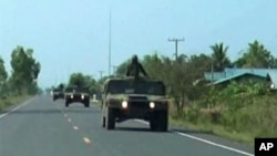 Thai military trucks with soldiers are driven to the Thai-Cambodia border for reinforcement in this still image taken from video April 22, 2011. Thai and Cambodian soldiers fought with rocket-propelled grenades and guns on their disputed border on Friday