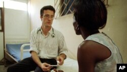 FILE - A physician talks to a patient who is HIV positive at a social and medical assistance clinic in Abidjan, Ivory Coast, Monday March 19, 2001.