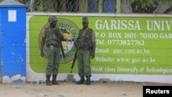 FILE - Kenya Administration policemen stand in front of Garissa University College in Garissa, April 4, 2015.