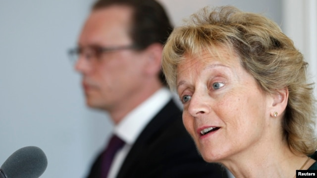 Swiss Finance Minister Eveline Widmer-Schlumpf (R) speaks to media next to European Commissioner for Taxation and Customs Union, Audit and Anti-Fraud Algirdas Semeta during a news conference in Bern, June 17, 2013.