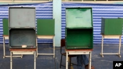 Empty ballot boxes are shown before voting in Bangkok, Feb. 2, 2014.
