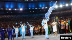 Flag-bearer Mohamed Daud Mohamed of Somalia leads his contingent during the opening ceremony at the 2016 Rio Olympics in Rio de Janeiro, Brazil, Aug. 5, 2016.