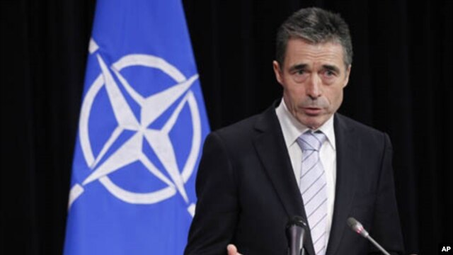 NATO Secretary General Anders Fogh Rasmussen addresses a news conference during a NATO defense ministers meeting at the Alliance headquarters in Brussels, February 3, 2012.
