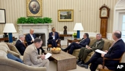 President Barack Obama and Vice President Joe Biden meet with, clockwise from the President, Defense Secretary Leon Panetta, Lieutenant General John Allen, National Security Advisor Tom Donilon, Chairman of the Joint Chiefs of Staff Admiral Mike Mullen, a