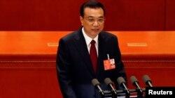 中国国务院总理李克强2018年3月5日在北京人民大会堂举行的全国人大会议开幕式上发表政府工作报告。
