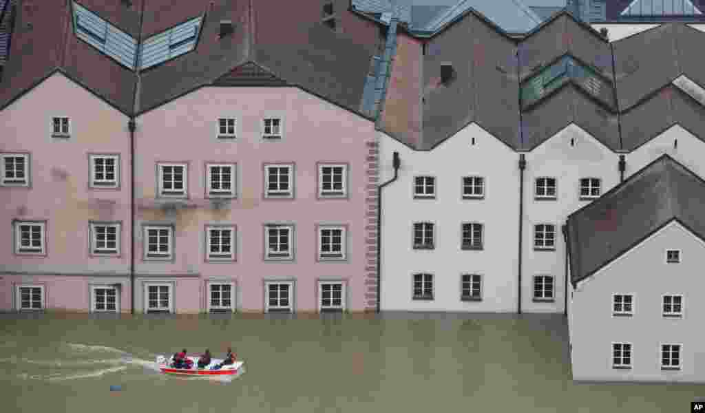 Members of the Red Cross make their way by boats in the flooded street in the center of Passau, southern Germany. Raging waters from three rivers have flooded large parts of the southeast German city following days of heavy rainfall in central Europe.