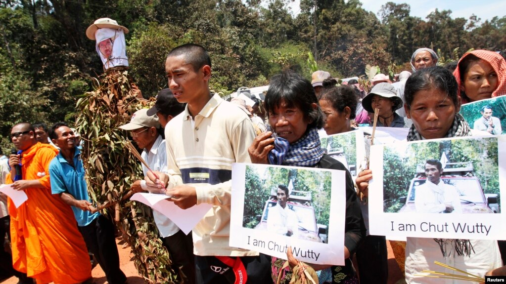 FILE - People march to the killing site of Cambodian anti-logging activist Chut Wutty in Koh Kong province, May 11, 2012.