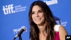 FILE - Actress Sandra Bullock speaks to the press at the Toronto International Film Festival, in Toronto, Canada, Sept. 9, 2013.