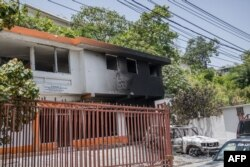 A charred car and building are pictured near the Petionville Police station where suspects of being involved in the assassination of President Jovenel Moise are being held, in Petionville, Haiti, July 9, 2021.