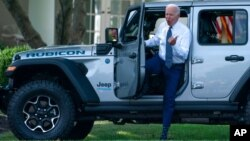 President Joe Biden gets out of a Jeep Wrangler Rubicon 4xE on the South Lawn of the White House in Washington, Aug. 5, 2021.