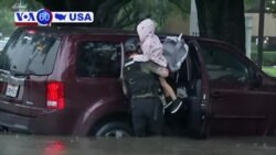 VOA60 America - Tropical Storm Imelda continued to dump torrential rains on southeastern Texas Friday