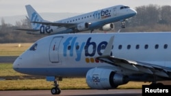 A Flybe plane takes off from Manchester Airport in Manchester, Britain, Jan. 20, 2020.