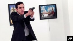 Burhan Ozbilici's photo of this gunman assassinating the Russian ambassador to Turkey late last year won a major award on Monday.