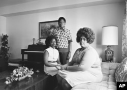 Linda Brown, right, and her two children pose for a photo in their home in Topeka, Kansas.