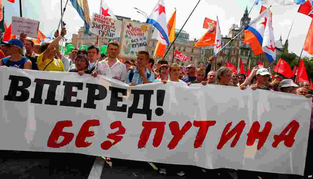 "Protesters carry a banner reading, ""Russia Go Forward without Putin"" in Moscow."