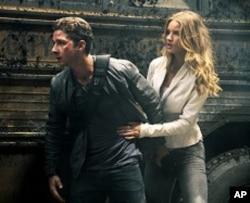Left to right: Shia LaBeouf plays Sam Witwicky and Rosie Huntington- Whiteley plays Carly in TRANSFORMERS: DARK OF THE MOON, from Paramount Pictures.