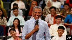 FILE - U.S. President Barack Obama smiles as he takes questions from the floor at the Young Southeast Asian Leaders Initiative (YSEALI) town hall meeting at Taylor's University in Kuala Lumpur, Malaysia, Nov. 20, 2015.