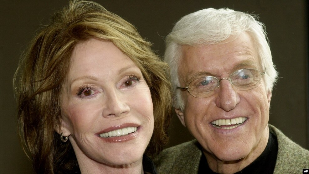 "FILE - Mary Tyler Moore and Dick Van Dyke pose together following a press conference announcing their reunion in a new television adaptation of the play, ""The Gin Game,"" part of the drama series ""PBS Hollywod Presents,"" in Los Angeles' Hollywood district,"
