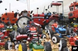 Just a few of the many toy vehicles Munyuki makes from scrap that he collects all over southern Africa