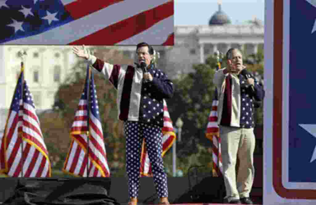 "Comedians Stephen Colbert, left, and Jon Stewart perform during their Rally to Restore Sanity and/or Fear on the National Mall in Washington, Saturday, Oct. 30, 2010. The ""sanity"" rally blending laughs and political activism drew thousands to the mall wi"