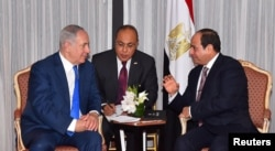 Egyptian President Abdel Fattah el-Sissi, right, speaks with Israeli Prime Minister Benjamin Netanyahu, left, during their meeting as part of an effort to revive the Middle East peace process ahead of the United Nations General Assembly in New York, Sept. 19, 2017 in this handout picture courtesy of the Egyptian Presidency.