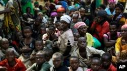 FILE - Refugees who fled Burundi's violence wait to board a U.N. ship, at Kagunga on Lake Tanganyika, Tanzania, to be taken to the port city of Kigoma, May 23, 2015.